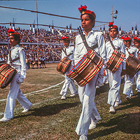 Bengali youth band march at a stadium in Dhaka, Bangladesh, celebrating thier recent independence from Pakistan. 1977 photo