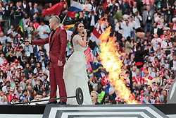 June 14, 2018 - Moscow, Russia - Robbie Wiliams and Aida Garifullina performs during Opening Ceremony of FIFA World Cup 2018 before the group A match between Russia and Saudi Arabia at the 2018 soccer World Cup at Luzhniki stadium in Moscow, Russia, Tuesday, June 14, 2018. (Credit Image: © Anatolij Medved/NurPhoto via ZUMA Press)