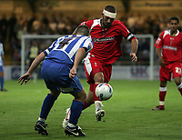 Photo: Paul Thomas.<br /> Chester City v Swindon Town. Coca Cola League 2. 01/09/2006.<br /> <br /> Christian Roberts (R) of Swindon tries to run by Stephen Vaughan.