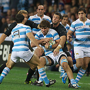Argentina No8 Juan Martin Fernandez Lobbe is tackled during the England V Argentina, Pool B match during the Rugby World Cup in Dunedin, New Zealand,. 10th September 2011. Photo Tim Clayton