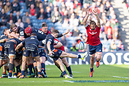 Arno Botha (#20) of Munster Rugby attempts to charge down the kick of Henry Pyrgos (#9) of Edinburgh Rugby during the Heineken Champions Cup quarter-final match between Edinburgh Rugby and Munster Rugby at BT Murrayfield Stadium, Edinburgh, Scotland on 30 March 2019.