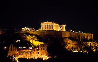 The Parthenon atop the Acropolis illuminated at night, Athens, Greece.(The Odeon of Herodes Atticus in foreground)