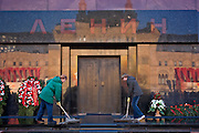 Moscow, Russia, 06/11/2005..Kremlin claeaners wash the entrance to Lenin's Mausoleum on Red Square after Communists had laid wreathes to mark the 88th anniversary of the 1917 Bolshevik Revolution.