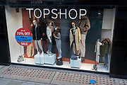As the UK reacts to Prime Minister Boris Johnson's announcement of Lockdown 2 during the second wave of the Coronavirus pandemic, a staff member dresses a female mannequin in the window of clothing retailer Topshop, on 2nd November 2020, in London, England. From midnight on Thursday, all non-essential shops, bars, restaurants and other small businesses will have to closed, according to government Covid restrictions - and for a minimum of 4 weeks in the run-up to Christmas.