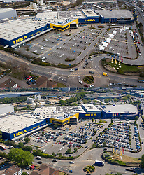 NOTE TO EDITORS - COMBINED IMAGE © Licensed to London News Pictures. 01/06/2020. London, UK. In this combined image a photograph (top from 1/04/2020) shows the coronavirus test centre open at IKEA in Wembley, north London compared to today (lower image) as the store opens to customers who fill the car park. The government have announced new measures from today to allow groups of six people to meet outdoors and primary schools to re-open. Photo credit: Peter Macdiarmid/LNP