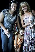 JAVIER CALVELO/  MONTEVIDEO/ TIPOS HUMANOS - Shopping Nuevo Centro<br /> Proyecto documental sobre la identidad, lo nacional, lo Uruguayo y el consumo. Se trata de retratos simples mirando a camara y con un fondo neutro. Les pregunto a los fotografiados como quieren ser recordados en el futuro, sus nombres y que hacen.<br /> El trabajo esta influenciado por la obra de August Sander pero tambien por Richard Avedon y Manuel Alvarez Bravo. <br /> El titulo esta basado en la obra de Raymond Firth, Tipos Humanos. (Raymond William Firth, ( 1901-2002) fue un etnólogo neozelandés profesor de Antropología en la London School of Economics, es uno de los fundadores de la antropología económica británica). <br /> En la foto:  Tipos Humanos en el Shopping Nuevo Centro.Larisa . Foto: Javier Calvelo <br /> la6ko9li@gmail.com preguntar nombre de los tres<br /> 2013-12-20 dia viernes