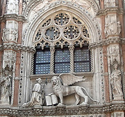 Detail of the Doge's Palace entrance, Venice. Built in Venetian Gothic style the palace was the residence of the Doge of Venice (the supreme authority of the rublic of Venice). It is now open as a museum.
