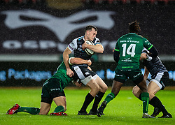 Cai Evans of Ospreys is tackled by Dominic Robertson-McCoy of Connacht<br /> <br /> Photographer Simon King/Replay Images<br /> <br /> Guinness PRO14 Round 6 - Ospreys v Connacht - Saturday 2nd November 2019 - Liberty Stadium - Swansea<br /> <br /> World Copyright © Replay Images . All rights reserved. info@replayimages.co.uk - http://replayimages.co.uk
