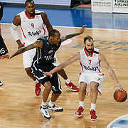 Anadolu Efes's Terence Kinsey (C) and Olympiacos's Vassilis Spanoulis (R) during their Turkish Airlines Euroleague Basketball Top 16 Group E Game 4 match Anadolu Efes between Olympiacos at Sinan Erdem Arena in Istanbul, Turkey, Wednesday, February 08, 2012. Photo by TURKPIX