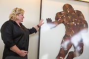 Bay Area artist Jenny Kompolt talks about her Running Back piece, which is pieced together entirely out of worn footballs, during the Levi's Stadium Art Collection grand opening event at Levi's Stadium in Santa Clara, California, on August 1, 2014. (Stan Olszewski/SOSKIphoto for Content Magazine)