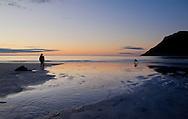 Photographers on the beach at sunset, Lofoten Islands, Arctic Norway