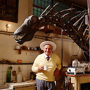 """Jose Bonaparte with Amargasaurus, a """"jibbed"""" sauropod in the kitchen of the paleontology department of the Museo de Ciencias Naturales de Buenos Aires."""