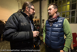 LowRide Magazine editor Giuseppe Roncen and 70's Helmets' Fabrizio Caoduro at a party at the Motosplash complex with a show opening of Michael Lichter photographs in the Italian Choppers gallery during EICMA, the largest international motorcycle exhibition in the world. Milan, Italy. November 20, 2015.  Photography ©2015 Michael Lichter.