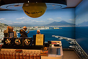 Duty Free customer and a picture of the Bay of Naples at Naples airport. The national emergency plan to protect the inhabitants from a possible eruption of the Vesuvius area has as its baseline the explosive event of 1631. Drafted by the scientific community has identified three areas with different hazard defined: the red zone, yellow zone and the blue zone. The red zone is the area immediately surrounding the volcano, and is in greater danger as potentially subject to invasion by pyroclastic flows, or mixtures of gases and solids at high temperature which, sliding along the slopes of the volcano at high speed can destroy in a short time everything is on its way. Pyroclastic flows probably will not grow at 360 ° in the neighborhood of the volcano, but will head in one or more preferential directions