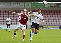Jonson Clarke-Harris of Peterborough United battles with Fraser Horsfall of Northampton Town - Mandatory by-line: Joe Dent/JMP - 10/10/2020 - FOOTBALL - PTS Academy Stadium - Northampton, England - Northampton Town v Peterborough United - Sky Bet League One