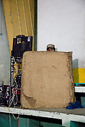 Sound engineer behind cardboard wall. Lucha Libre wrestling origniated in Mexico, but is popular in other latin Amercian countries, including in La Paz / El Alto, Bolivia. Male and female fighters participate in the theatrical staged fights to an adoring crowd of locals and foreigners alike.