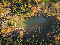 Aerial view of mountain lake with wooden walkway, Champery, Switzerland.