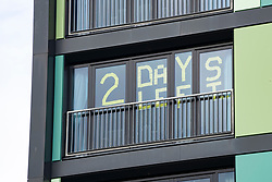 Edinburgh, Scotland, UK. 5 October, 2020. Message in window of Napier University's Bainfield Student apartments at Fountainbridge stating that their period of self-isolation has 2 days remaining. Students at Scottish universities were told to self-isolate after several outbreaks of Covid-19 were recorded. Iain Masterton/Alamy Live News