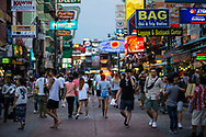 Evening descends on Khao San Road, a pedestrian street in Bangkok popular with both tourists and Thais and lined with shops, bars, restaurants, and guesthouses. (Bangkok, Thailand - June 2017)