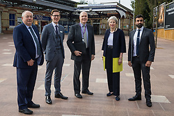 Theresa May, Conservative MP for Maidenhead, stands with (l-r) Bob Beveridge (Chairman, Thames Valley Berkshire Local Enterprise Partnership), Tom Pierpoint (Business Development Director, GWR), Cllr Gerry Clark (Royal Borough of Windsor and Maidenhead's cabinet member for transport and infrastructure) and Asim Zeb (Project Centre) on the occasion of the official opening of a new station forecourt on 11th October 2021 in Maidenhead, United Kingdom. The £3.75m refurbishment is intended to make the area around the station more commuter-friendly in anticipation of an increase in passengers when Crossrail opens and to improve both the interchange between trains and other forms of transport and walking and cycling links between the station and the town centre.
