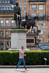 Glasgow, Scotland, UK. 12 June 2020. Police patrol George Square in the city centre to prevent vandalism to the many historic statues located here. Following the recent Black Lives Matter demonstrations in the UK,  many colonial era statues have been targeted by protestors. Pictured; Robert Peel statue in foreground. Iain Masterton/Alamy Live News