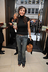 MARIE HELVIN at a reception hosted by Vogue and Burberry to celebrate the launch of Fashions Night Out - held at Burberry, 21-23 Bond Street, London on 10th September 2009.