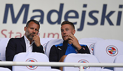 Wales manager Ryan Giggs (left) and Chris Gunter in the stands before the Sky Bet Championship match at the Madejski Stadium, Reading