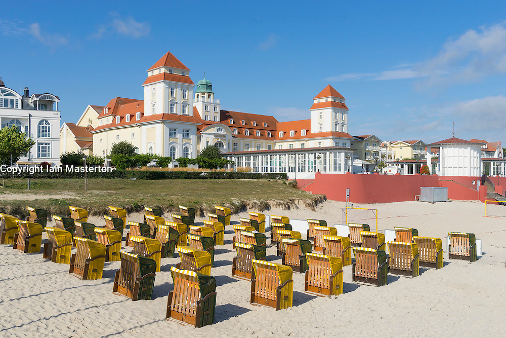 View of traditional Strandkorb seats on beach and Kurhaus Binz Hotel at Binz seaside resort on Rugen Island in Germany