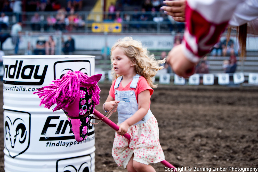 Kids run the stick horse race at the Gem State Stampede August 25th, 2018 2nd perf in Couer D'Alene ID.  Photo by Josh Homer/Burning Ember Photography.  Photo credit must be given on all uses.
