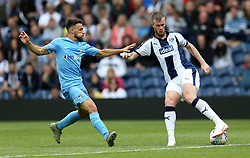 West Bromwich Albion's Chris Brunt (right) and Coventry City's Tony Andreu (left) battle for the ball during the Cyrille Regis Memorial Trophy match at The Hawthorns, West Bromwich.