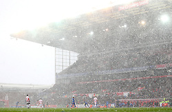 Heavy snow continues to fall during the Stoke City v Everton match at bet365 Stadium