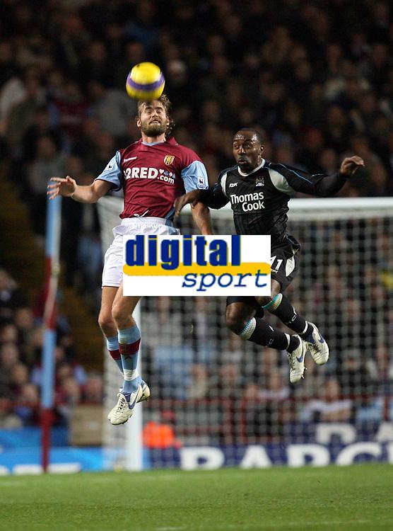 Photo: Rich Eaton.<br /> <br /> Aston Villa v Manchester City. The Barclays Premiership. 29/11/2006. Olof Mellberg left of Villa outjumps City goalscorer Darius Vassell