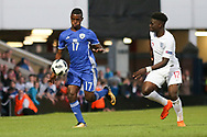 Hanan Hen Biton of Israel (17) and Bukayo Saka of England (17) chase the ball during the UEFA European Under 17 Championship 2018 match between England and Israel at Proact Stadium, Whittington Moor, United Kingdom on 4 May 2018. Picture by Mick Haynes.