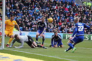 a goalmouth scramble sees Aron Gunnarsson © and Anthony Pilkington (on ground) denied by Preston defender Bailey Wright (l) and Preston goalkeeper Anders Lindegaard. Skybet football league championship match, Cardiff city v Preston NE at the Cardiff city stadium in Cardiff, South Wales on Saturday 27th Feb 2016.<br /> pic by  Andrew Orchard, Andrew Orchard sports photography.