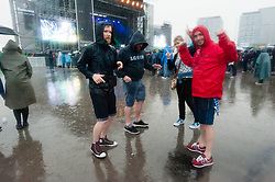 © Licensed to London News Pictures. 30/05/2014. Barcelona, Spain.   Torrential rain pours down on festival goers who dance in the puddles whilst watching a band perform Primavera Sound festival, Barcelona.  Primavera Sound festival, or simply Primavera, is an annual music festival that takes place in Barcelona, Spain in late May/June within the Parc del Fòrum leisure site. Photo credit : Richard Isaac/LNP