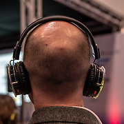 People wearing headphone to listen to a speaker at London Tech Week at Excel London,on 12 June 2019, UK