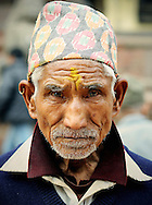 Nepal, Patan. Man wearing a topi - traditional nepalese headdress.
