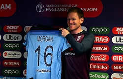 England cricket captain Eoin Morgan holds up the new England shirt during the press conference at Edgbaston, Birmingham.