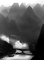 The Li River winds it way through Yangshuo dwarfed by the surrounding limestone karsts.