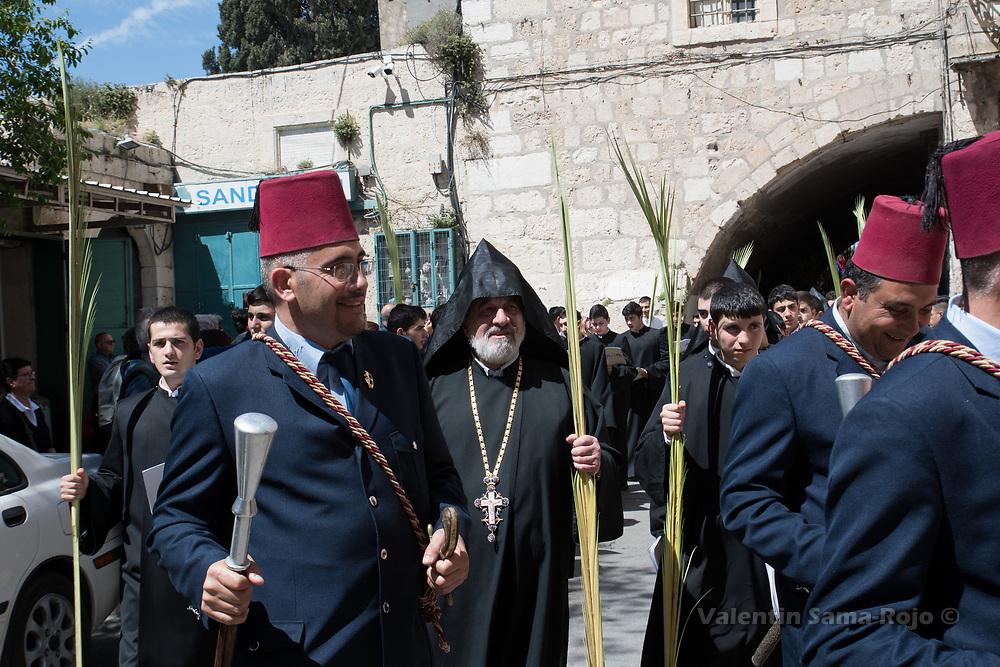 Jerusalem, Israel. 1st April, 2018. The Armenian Vicar of Jerusalem (C) arriving to Saint James Cathedral during the Armenian Palm Sunday procession. © Valentin Sama-Rojo.