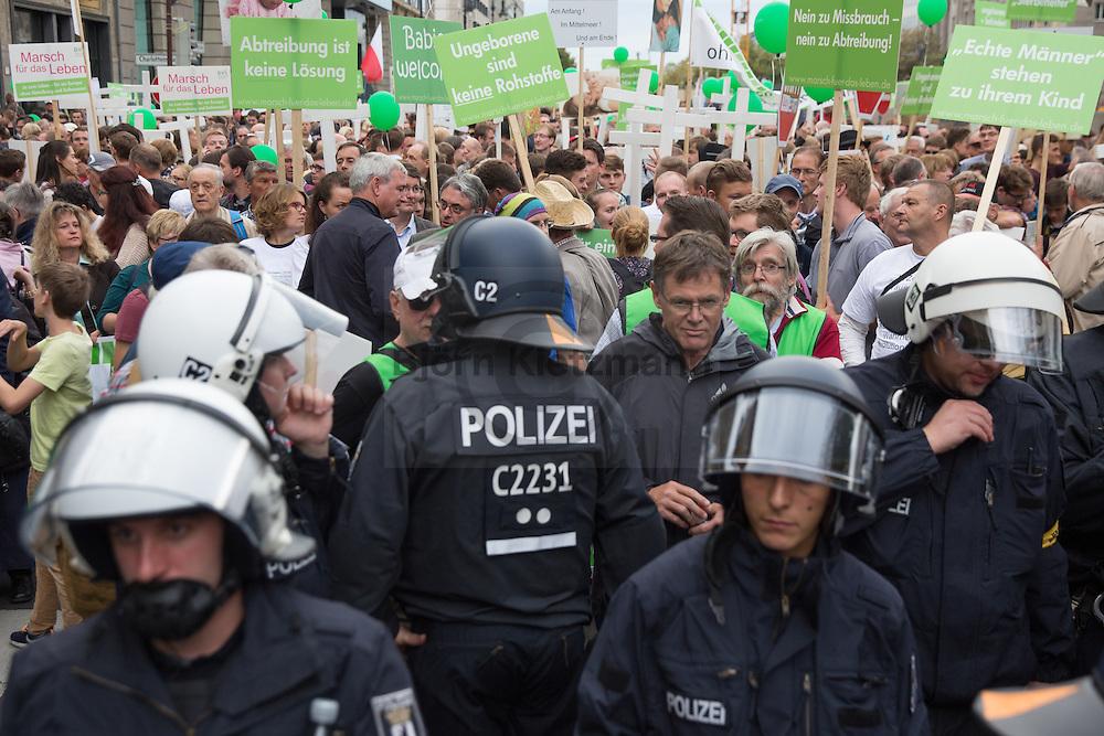 """Berlin, Germany - 19.09.2015  <br /> <br /> About 5,000 protestors join a Christian fundamentalist anti-abortion march in Berlin. The """"march for life"""" was accompanied by massive feminist counter protests.<br /> <br /> Etwa 5.000 Menschen beteiligen sich an einer christlich-fundamentalistischen Demonstration von Abtreibungsgegnern in Berlin. Der """"Marsch fuer das Leben"""" wurde von massiven feministischen Gegenprotesten begleitet.<br /> <br /> Photo: Bjoern Kietzmann"""
