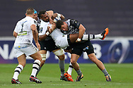 Alivereti Raka of Clermont © is halted by Justin Tipuric (l) and Kieron Fonotia ® of the Ospreys. European Rugby Champions Cup, pool 2 match, Ospreys v ASM Clermont Auvergne at the Liberty Stadium in Swansea, South Wales on Sunday 15th October 2017.<br /> pic by  Andrew Orchard, Andrew Orchard sports photography.