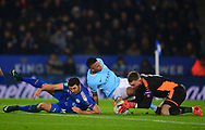 Ben Hamer , the goalkeeper of Leicester city hangs onto the ball as Gabriel Jesus of Manchester city slides in to challenge. Carabao Cup quarter final match, Leicester City v Manchester City at the King Power Stadium in Leicester, Leicestershire on Tuesday 19th December 2017.<br /> pic by Bradley Collyer, Andrew Orchard sports photography.