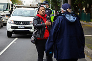 As a woman is arrested for ignoring an order to leave, her friend pleads with police to release her amid the third full day of the total lockdown of 9 housing commission high rise towers in North Melbourne and Flemington during COVID 19.After recording 191 COVID-19 cases overnight forcing Premier Daniel Andrews to announce today that all of metropolitan Melbourne along with one regional centre, Mitchell Shire will once more go back to stage three lockdowns from midnight Wednesday June 8. This comes as the residents of the housing commission towers in North Melbourne and Flemington finish their third day under extreme lockdown, despite only 27 cases being found in the towers. Members of the public gathered outside of the towers this afternoon in support of those trapped inside while riot police arrested two women for standing too close to the fence. While the women were later released, tensions are boiling over both in the towers and out. With 772 active cases in Victoria, NSW closed their border to Victoria effective at midnight tonight.