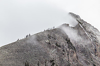 A snowstorm blowing in over the top of East Beckwith Mountain of the West Elk Mountains, Colorado.