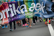 """Official banner on the 20th Korrika.  Irun (Basque Country). April 4, 2017. The """"Korrika"""" is a relay course, with a wooden baton that passes from hand to hand without interruption, organised every two years in a bid to promote the basque language. The Korrika runs over 11 days and 10 nights, crossing many Basque villages and cities. This year was the 20th edition and run more than 2500 Kilometres. Some people consider it an honour to carry the baton with the symbol of the Basques, """"buying"""" kilometres to support Basque language teaching. (Gari Garaialde / Bostok Photo)"""