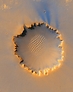 Victoria Crater, impact crater at Meridiani Planum, near equator of Mars, approximately 800 meters in diameter.  'Scalloped' rim is caused by erosion. Credit NASA. Science Astronomy  Planet