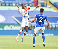 LEICESTER, ENGLAND - JULY 04: Christian Benteke of Crystal Palace controls the ball with his chest ahead of James Justin of Leicester City during the Premier League match between Leicester City and Crystal Palace at The King Power Stadium on July 4, 2020 in Leicester, United Kingdom. Football Stadiums around Europe remain empty due to the Coronavirus Pandemic as Government social distancing laws prohibit fans inside venues resulting in all fixtures being played behind closed doors. (Photo by MB Media)