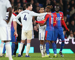 Crystal Palace's Wilfried Zaha (2nd right) and Cardiff City captain Sean Morrison have a discussion, during a break in play at the Premier League match at Selhurst Park, south east London.