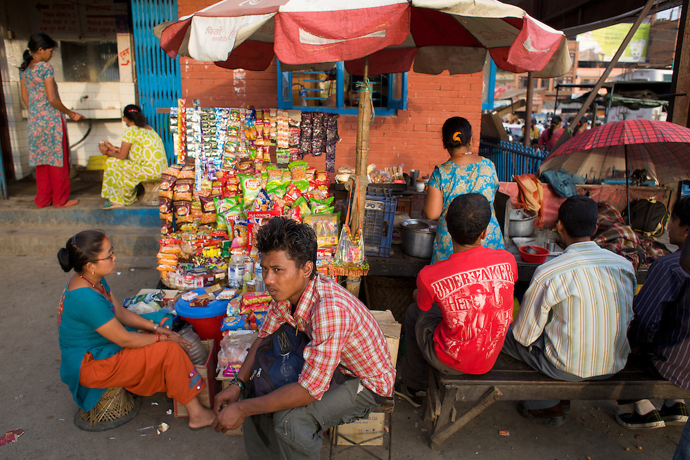 Evening crowds at a market and bus terminal in Kathmandu...Photo: Tom Pietrasik.Kathmandu, Nepal.April 19th 2010